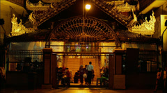 Buddhists visit Sule Pagoda at night. Yangon Stock Footage