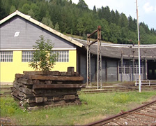 Murzzuschlag railway yard, stack of railway sleepers + railway shed Stock Footage