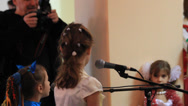 Stock Video Footage of Children, participate in a concert at the College. Celebration of New Year.
