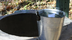 Well and bucket of water Stock Footage