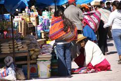 quechua indian women bargain - stock photo