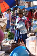 Stock Photo of quechua indian women bargain