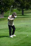 Woman golfer teeing off Stock Photos