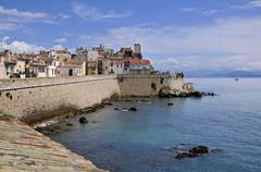 Sea and walled town of Antibes in France - stock photo