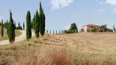 Woman walking on a path in tuscany Stock Footage