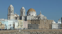 Stock Video Footage of View towards Cadiz Cathedral, Campo del Sur promenade, Cadiz, Andalusia, Spain.