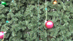 Close up of christmas tree branches with pink bubbles Stock Footage