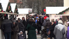 Winter holiday market town at cathedral square people Stock Footage