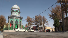 Iran village, colorful prayer hall on middle of the road Stock Footage