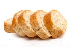cutted long loaf with bran - stock photo
