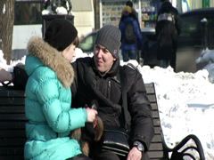 Two young men sitting on a bench in Siberia (Irkutsk) - stock footage