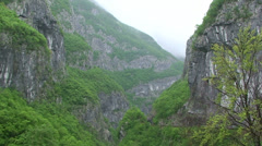 Raining on a river canyon Stock Footage