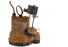 Old grungy rusted sump pump Stock Photos