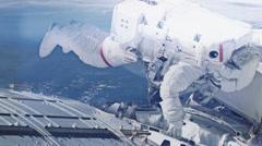 Astronaut making repairs - HD - stock footage