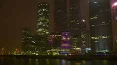 Establishing shot. Modern offcie buildings by river at winter night, Moscow Stock Footage