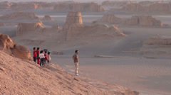 Iran, father and kids watch sunset in spectacular desert landscape Stock Footage