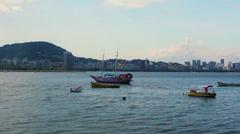 Sailboat and Fishing Boats Stock Footage