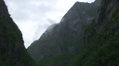Clouds dancing on river canyon Stock Footage