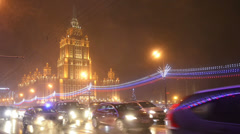 Establishing shot. Moscow, New year time, night hotel Ukrain and traffic. Stock Footage