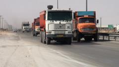 Industrial trucks on highway in Iran Stock Footage
