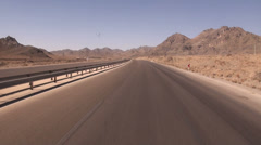 Iran, driving on a desert highway with public bus Stock Footage