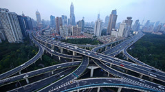 Time lapse,heavy traffic on highway interchange,Aerial View of Shanghai Skyline Stock Footage