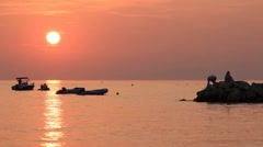 Croatia, Boats, people and redsunset 3 family silhouette and sea Stock Footage