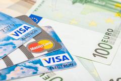 Visa Credit And Mastercard Cards Over Euro Banknotes Stock Photos