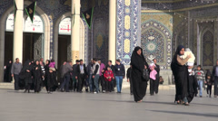 Families visit an important shrine in Qom, a religious city in Iran Stock Footage