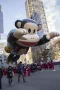 Julius balloon floats through city street during 2013 Macy's Parade Stock Photos