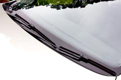 Windscreen wipers in resting position on windshield Stock Photos