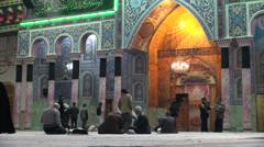Muslim men and women visit a popular shrine in Qom city in Iran Stock Footage