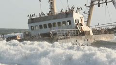 ship wreck in rolling waves at Skeleton Coast, Namibia 18 - stock footage