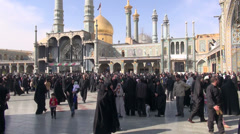 Iran, people exit shrine after important prayer session (handheld) Stock Footage