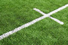 White stripe on the green soccer field from top view Stock Photos