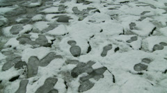 Rome in snow 34 (foot prints on path) Stock Footage