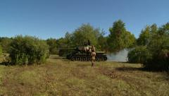 Russian tank enters orchard Stock Footage