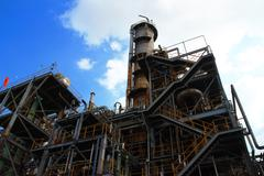 column tower in petrochemical plant and blue sky - stock photo
