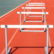 Running tracks with three hurdles set up for training Stock Photos