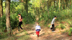 Woman and child picking pineal in the forest Stock Footage