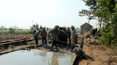 a group of people concreting the road - stock footage