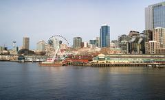 waterfront piers dock buildings needle ferris wheel seattle elliott bay - stock photo