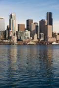 waterfront piers dock buildings ferris wheel boats seattle elliott bay - stock photo