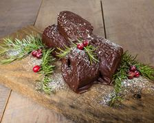 chocolate yule log with cranberries - stock photo