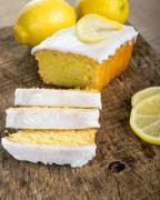 sliced lemon pound cake with white icing - stock photo