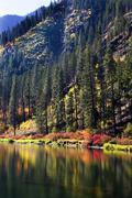Fall colors wenatchee river reflections yellow mountain leavenworth washingto Stock Photos