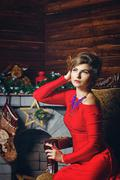 girl in red dress and christmas - stock photo