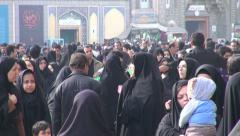 Iran women black chadors busy crowd holy shrine muslims Islam families Stock Footage
