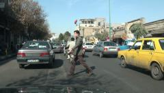 Man crosses the street on a busy road, vehicle shot, Qom, Iran Stock Footage