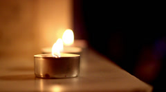 Three candle lights aligned to each other Stock Footage